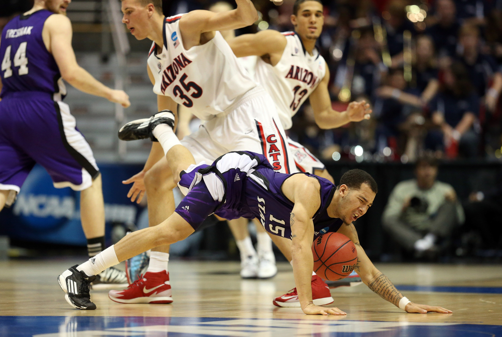 . Davion Berry #15 of the Weber State Wildcats gets tangled with Kaleb Tarczewski #35 of the Arizona Wildcats during the second round of the 2014 NCAA Men\'s Basketball Tournament at Viejas Arena on March 21, 2014 in San Diego, California.  (Photo by Jeff Gross/Getty Images)