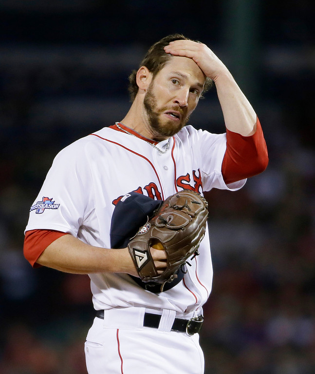 . Boston Red Sox relief pitcher Craig Breslow reacts after a double hit by Detroit Tigers shortstop Jhonny Peralta in the eighth inning during Game 1 of the American League baseball championship series Saturday, Oct. 12, 2013, in Boston. (AP Photo/Matt Slocum)