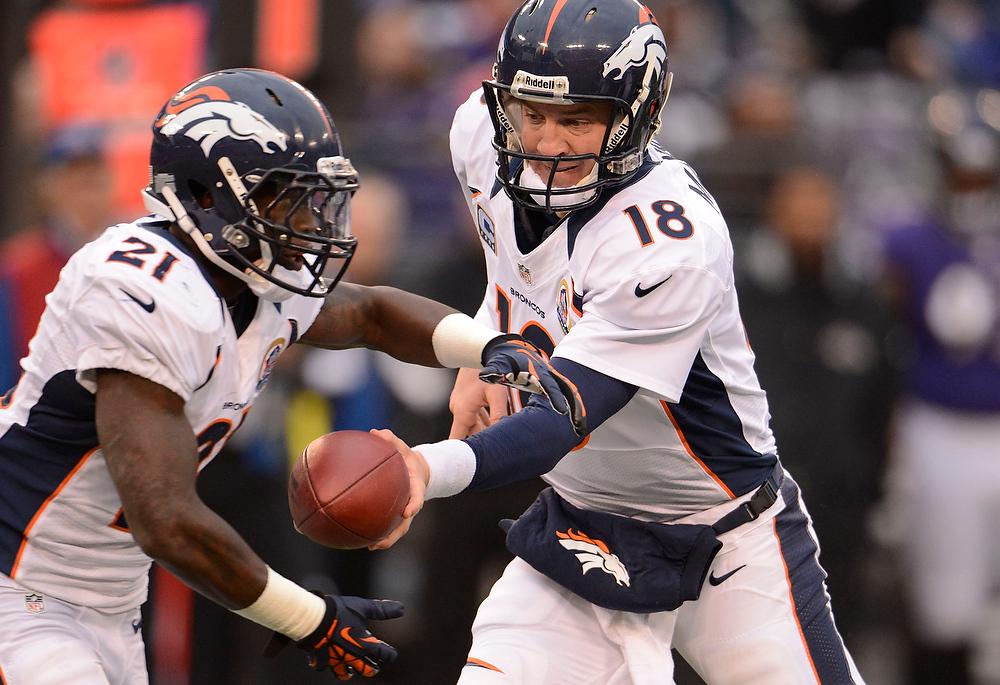 . Denver Broncos quarterback Peyton Manning (18) hands off to Denver Broncos running back Ronnie Hillman (21) during the fourth quarter Sunday, December 16, 2012 at M&T Bank Stadium. John Leyba, The Denver Post