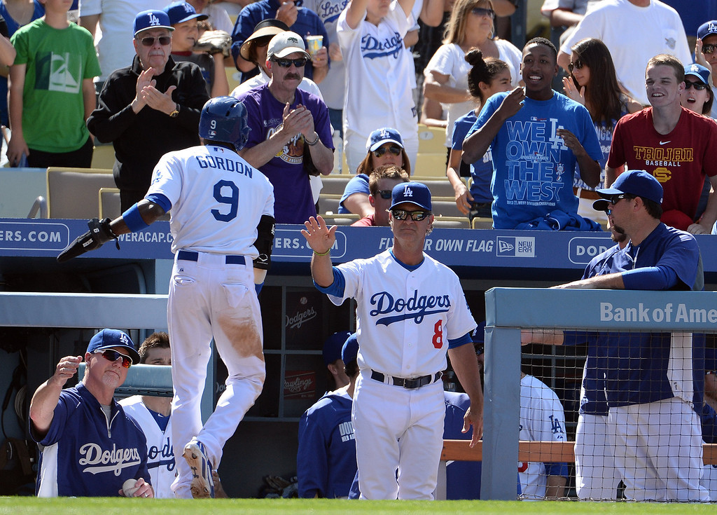 . Los Angeles Dodgers\' Dee Gordon (9) high fives manager Don Mattingly (8) after scoring on a Yasiel Puig double in the seventh inning of a Major league baseball game against the San Francisco Giants on Saturday, May 10, 2013 in Los Angeles.   (Keith Birmingham/Pasadena Star-News)