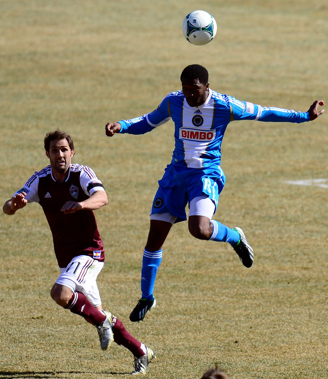 . COMMERCE CITY, CO - MARCH 10: Michael Lahoud (14) of the Philadelphia Union heads the ball as Brian Mullan (11) of the Colorado Rapids defends during the second half of action. The Colorado Rapids lose 2-1 to the Philadelphia Union at Dick\'s Sporting Goods Park. (Photo By AAron Ontiveroz/The Denver Post)