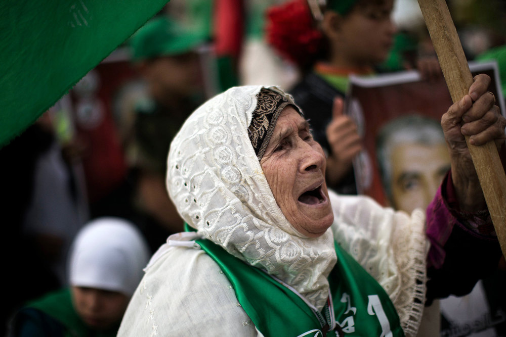 Description of . An elderly supporter of Hamas shouts slogans during a rally to mark the 25th anniversary of the founding of the Islamist movement, in Gaza on December 8, 2012. Tens of thousands of Palestinians massed in Gaza for a rally marking the anniversary to be addressed by Hamas leader in exile Khaled Meshaal, who is on his first ever visit to Gaza. MARCO LONGARI/AFP/Getty Images