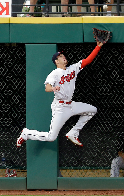 . Cleveland Indians\' Bradley Zimmer jumps but can\'t get to a one-run triple hit by San Diego Padres\' Jose Pirela in the fifth inning of a baseball game, Wednesday, July 5, 2017, in Cleveland. Luis Torrens scored on the play. (AP Photo/Tony Dejak)