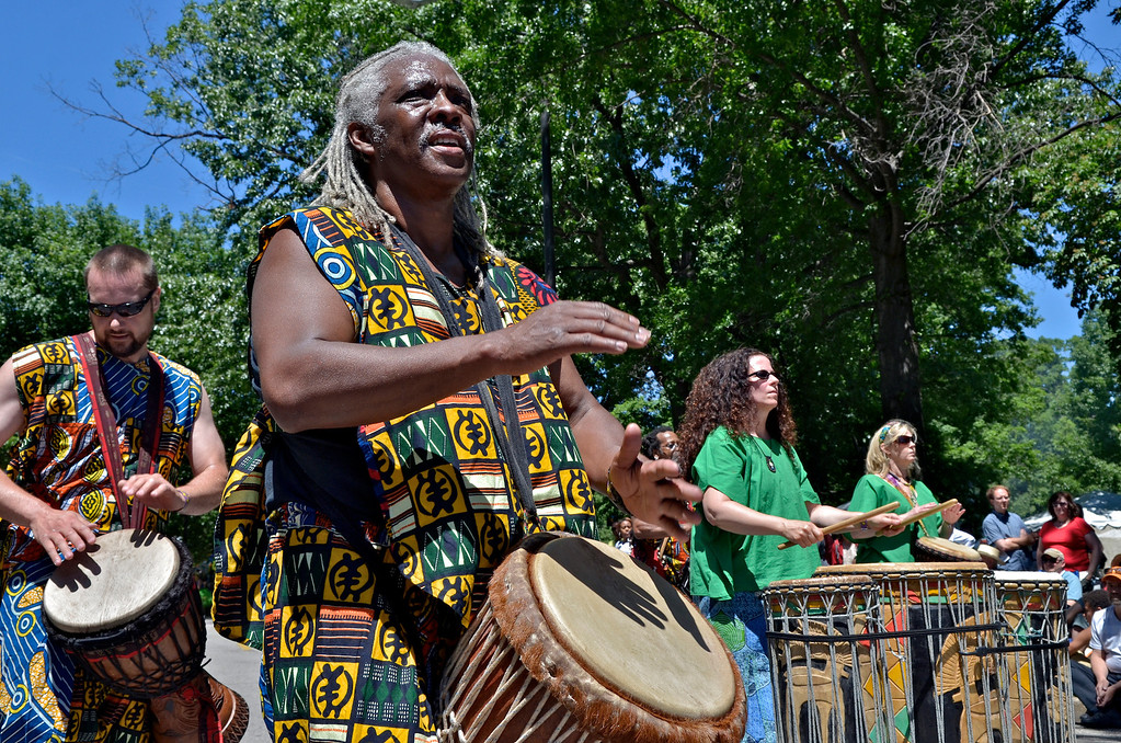 . Jeff Forman/JForman@News-Herald.com Don Davis plays a djembe drum with the Consciousness Community Drum Class during the Cleveland Museum of Art 25th annual Parade the Circle June 14 in University Circle.