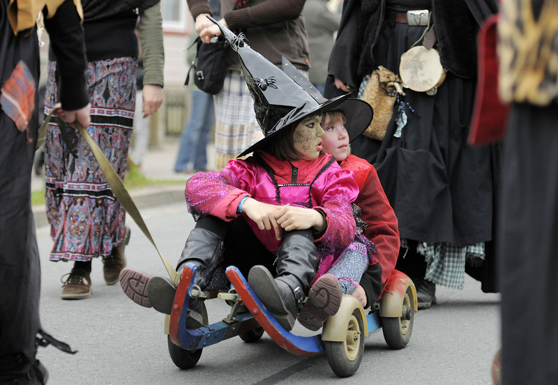 . Children costumed at witches take part at a procession in Schierke, central Germany, Tuesday, April 30, 2013. Hundreds of costumed devils and witches meet to celebrate Walpurgis Night, a traditional religious holiday of pre-Christian origins. The event is named after St. Walburga, an English nun who helped convert the Germans to Christianity in the 8th century. (AP Photo/Jens Meyer)