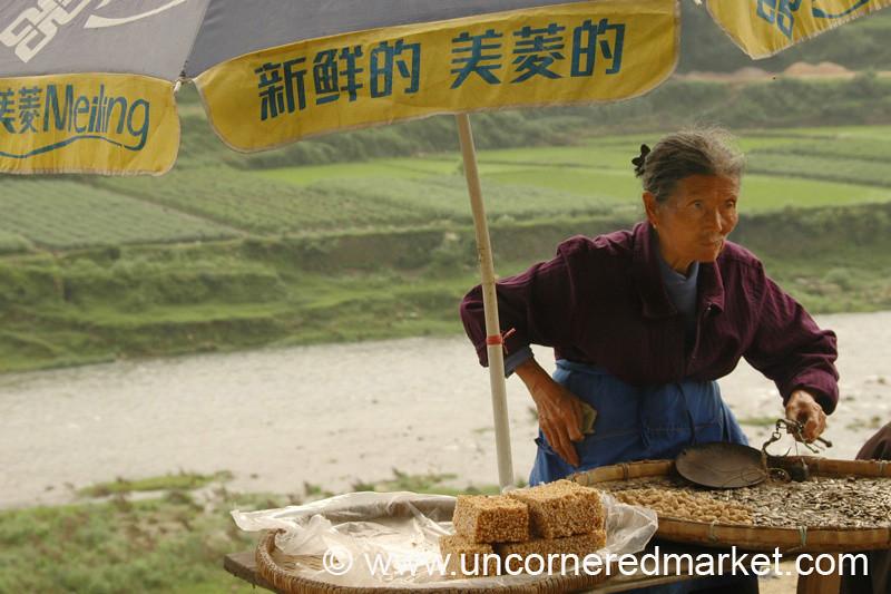 Woman Selling Nutty Snacks - Guizhou Province, China