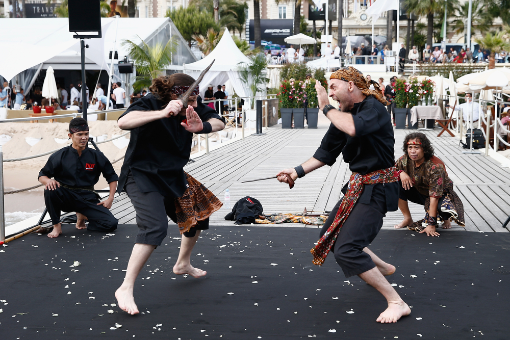 ". Performers demonstrate onstage at the ""Kilat\"" photocall at the 67th Annual Cannes Film Festival on May 16, 2014 in Cannes, France.  (Photo by Andreas Rentz/Getty Images)"