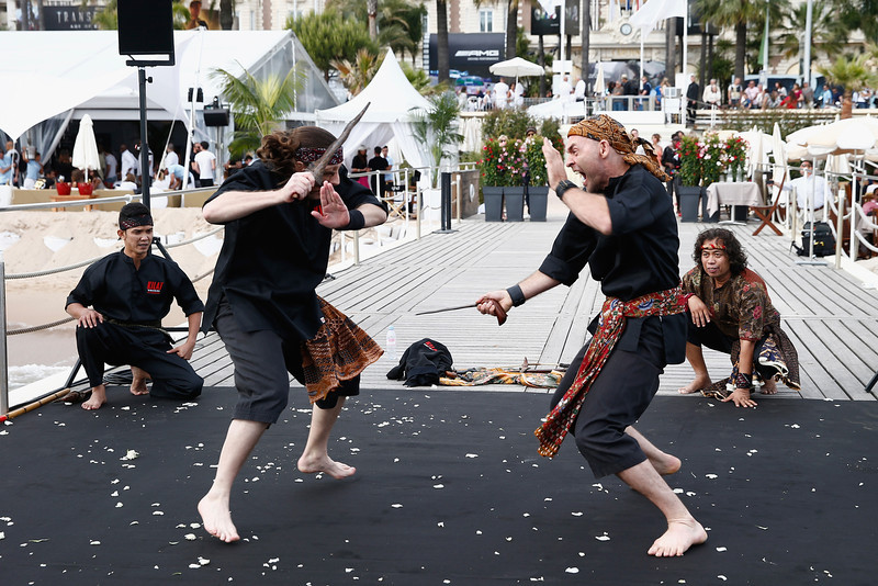 """. Performers demonstrate onstage at the \""""Kilat\"""" photocall at the 67th Annual Cannes Film Festival on May 16, 2014 in Cannes, France.  (Photo by Andreas Rentz/Getty Images)"""