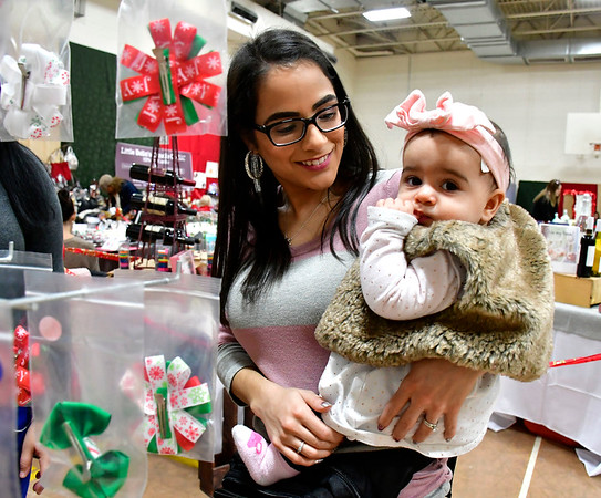 12/8/2018 Mike Orazzi | Staff Estephanie Kosinski and her daughter Miabella, 8 months, while at the YWCA New Britain Winter Wonderland Saturday in New Britain.