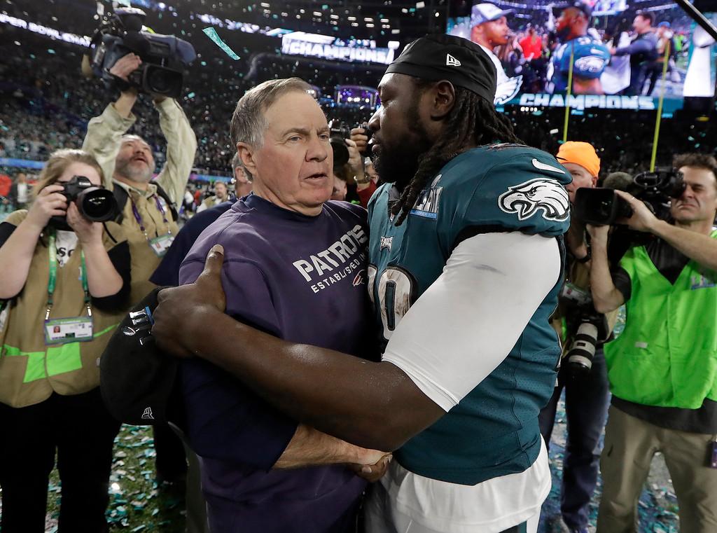 . New England Patriots head coach Bill Belichick, left, hugs Philadelphia Eagles\' LeGarrette Blount after the NFL Super Bowl 52 football game Sunday, Feb. 4, 2018, in Minneapolis. The Eagles won 41-33. (AP Photo/Mark Humphrey)