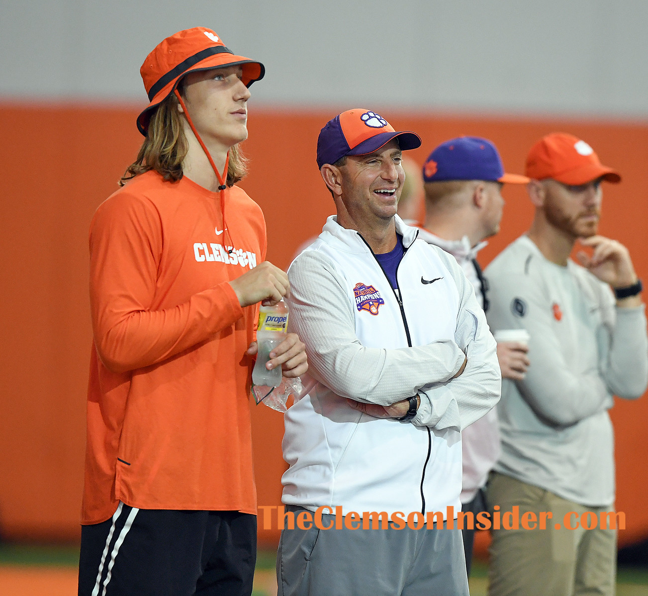 Clemson head coach Dabo Swinney watches the receivers with quarterback Trevor Lawrence during his football camp in Clemson Wednesday, June 12, 2019. Bart Boatwright/The Clemson Insider