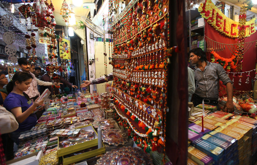 . Indians shop for decorative items and candles on the eve of Diwali, the Hindu festival of lights, in New Delhi, India, Saturday, Nov. 2, 2013. Hindus light up their homes and pray to Lakshmi, the goddess of wealth, during the festival which will be celebrated on Nov. 3. (AP Photo/Altaf Qadri)
