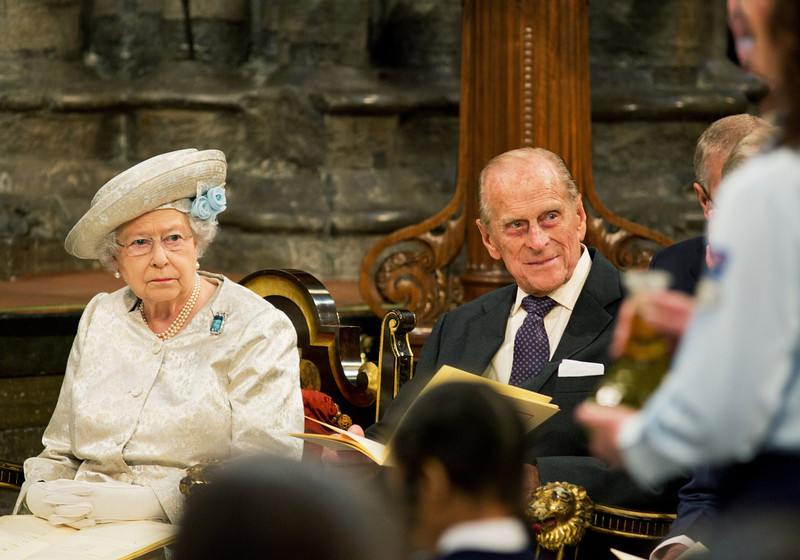 . Queen Elizabeth II and Prince Philip, The Duke of Edinburgh (R) look on during a service to Celebrate the 60th Anniversary of the Coronation Service at Westminster Abbey in London on June 4, 2013.  Queen Elizabeth II marked the 60th anniversary of her coronation with a service at Westminster Abbey filled with references to the rainy day in 1953 when she was crowned.  JACK HILL/AFP/Getty Images