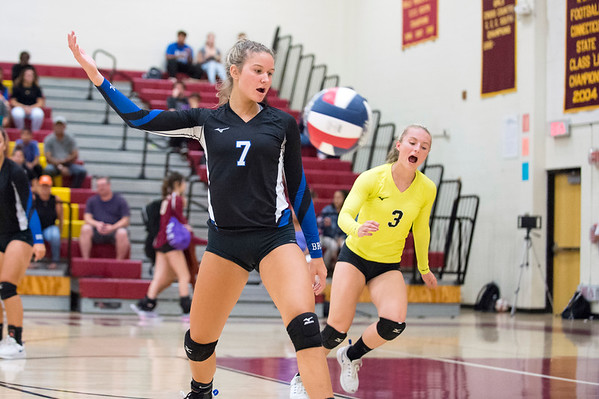 09/16/19 Wesley Bunnell | StaffrrBristol Eastern's Zoe Lowe (7) and Rebecca Bender (3) follow the New Britain serve during a game on Monday night at New Britain High School.