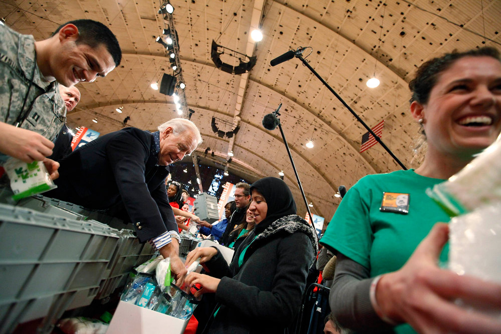 . U.S. Vice President Joe Biden (2nd R) joins volunteers to help assemble care kits for U.S. military service members and veterans at a Unite America in Service event at the National Guard Armory in Washington, January 19, 2013. Biden and his family volunteered for the event during the National Day of Service as part of the 57th Presidential Inauguration. REUTERS/Jonathan Ernst