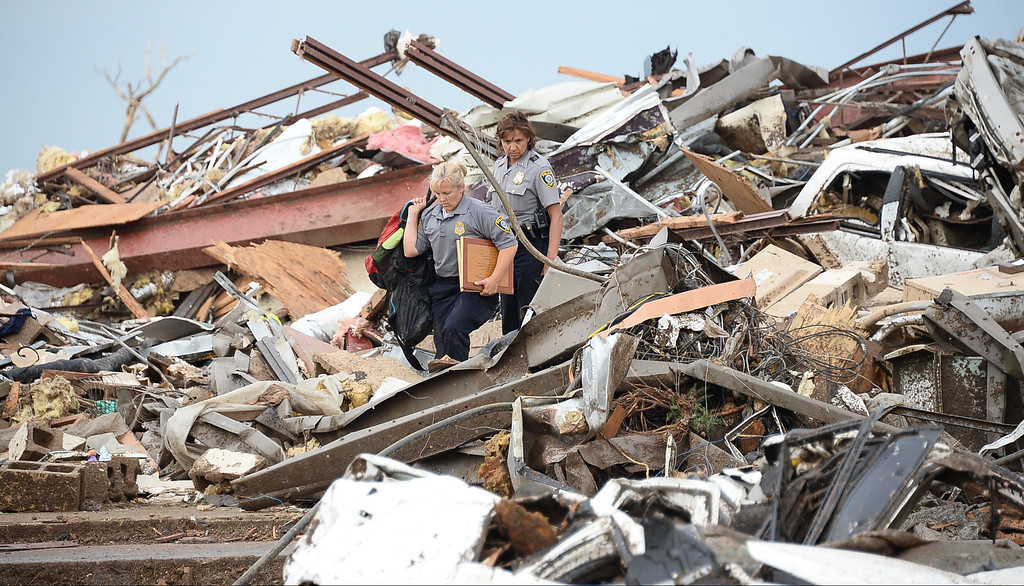. Rescues workers look for victims in a destroyed building at the Moore hospital parking lot. 