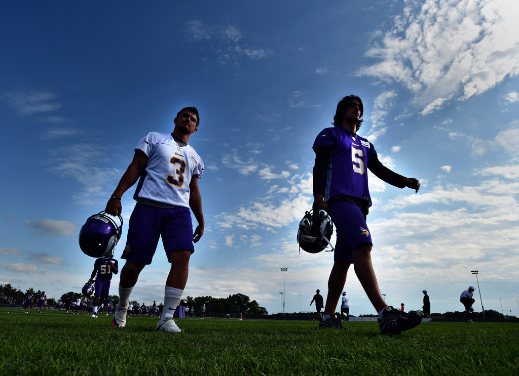 . Kicker Blair Walsh, left, and punter Chris Kluwe walk off the field at the end of practice on the second day of Vikings training camp in Mankato on Saturday, July 28, 2012.  (Pioneer Press: Chris Polydoroff)