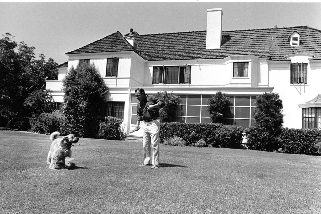 . Comedian Jonathan Winters plays with his family dog, Maude Frickert, named after Winters\' comedy character, on the lawn of his home at Toluca Lake, Ca., on Sept. 1, 1966.  (AP Photo)