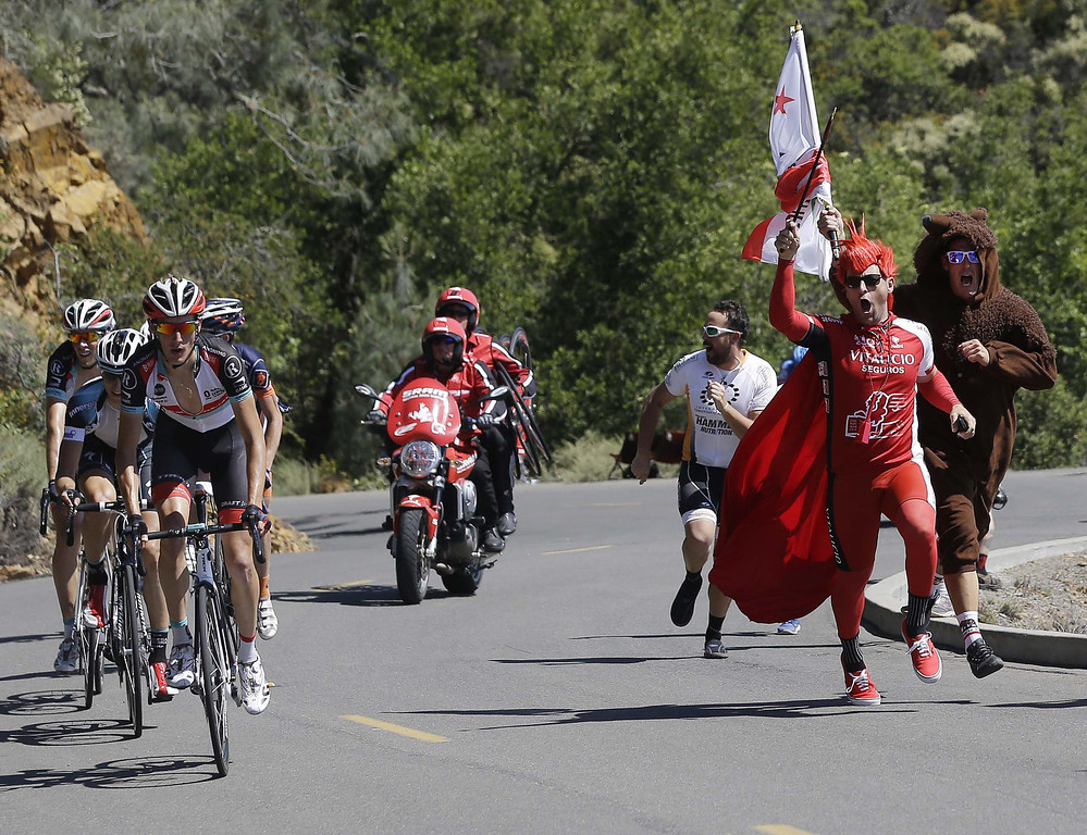. Fans cheer on Andy Schleck, front left, of Luxembourg, during stage 7 of the Tour of California cycling race in Mount Diablo, Calif., Saturday, May 18, 2013. (AP Photo/Marcio Jose Sanchez)