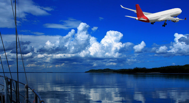 Jet Airliner Flying in an blue coloured cumulonimbus cloudy sky.