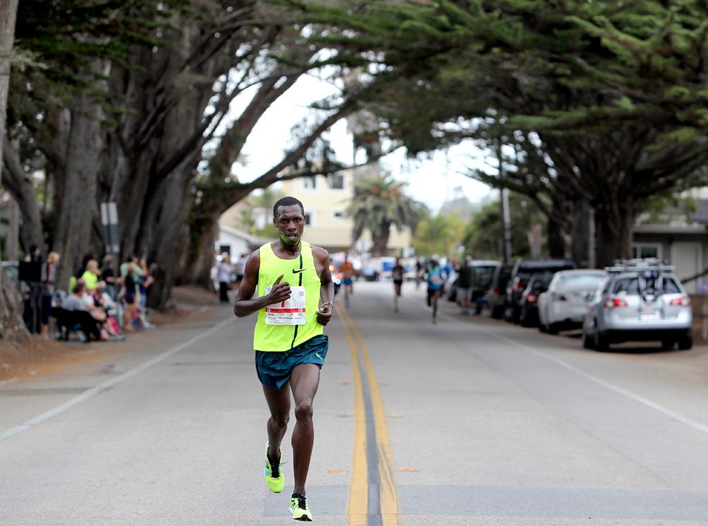 . Simon Ndirangu covers ground in Santa Cruz on Sunday during the Wharf to Wharf race. (Kevin Johnson -- Santa Cruz Sentinel)