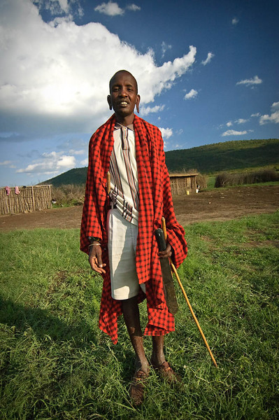 All Masai men have a stick and red blanket