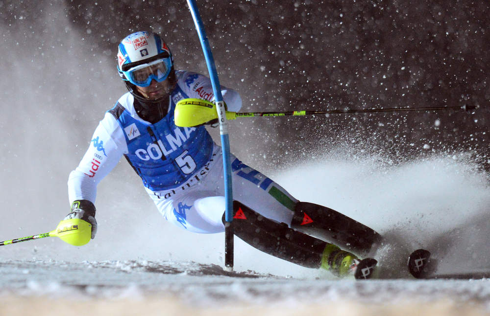 Description of . Christian Deville of Italy clears a gate in his second run in the FIS Alpine World Cup Men's Slalom on December 8, 2012 in Val d'Isere, French Alps. Alexis Pinturault of France won the race ahead Felix Neureuther of Germany and Marcel Hirscher of Austria. AFP PHOTO / FRANCK  FIFE/AFP/Getty Images