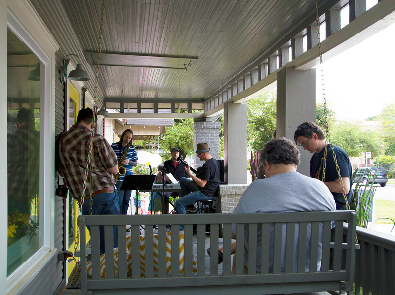 Group on porch watching the band.