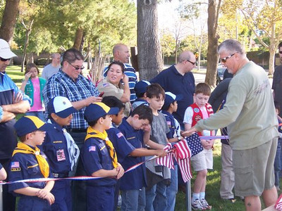 Scouts Planting Flags Around The Park