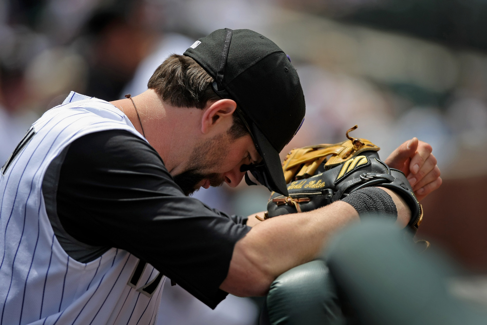 . First baseman Todd Helton #17 of the Colorado Rockies prepares to take the field against the New York Mets at Coors Field on May 25, 2008 in Denver, Colorado. The Rockies defeated the Mets 4-1.  (Photo by Doug Pensinger/Getty Images)
