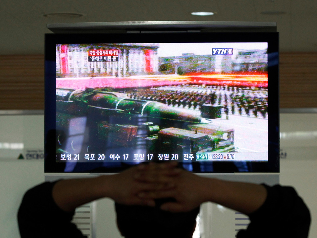 . A South Korean man who is waiting to head to the North Korean city of Kaesong, watches a news program airing file footage of a North Korean rocket displayed during a military parade at the customs, immigration and quarantine office in Paju, South Korea, near the border village of Panmunjom, Thursday, April 4, 2013. North Korea\'s vow to restart its mothballed nuclear facilities raises fears about assembly lines churning out fuel for a fearsome arsenal of nuclear-tipped missiles. But it may actually be a sign that Pyongyang needs a lot more bomb fuel to back up its nuclear threats. (AP Photo/Ahn Young-joon)