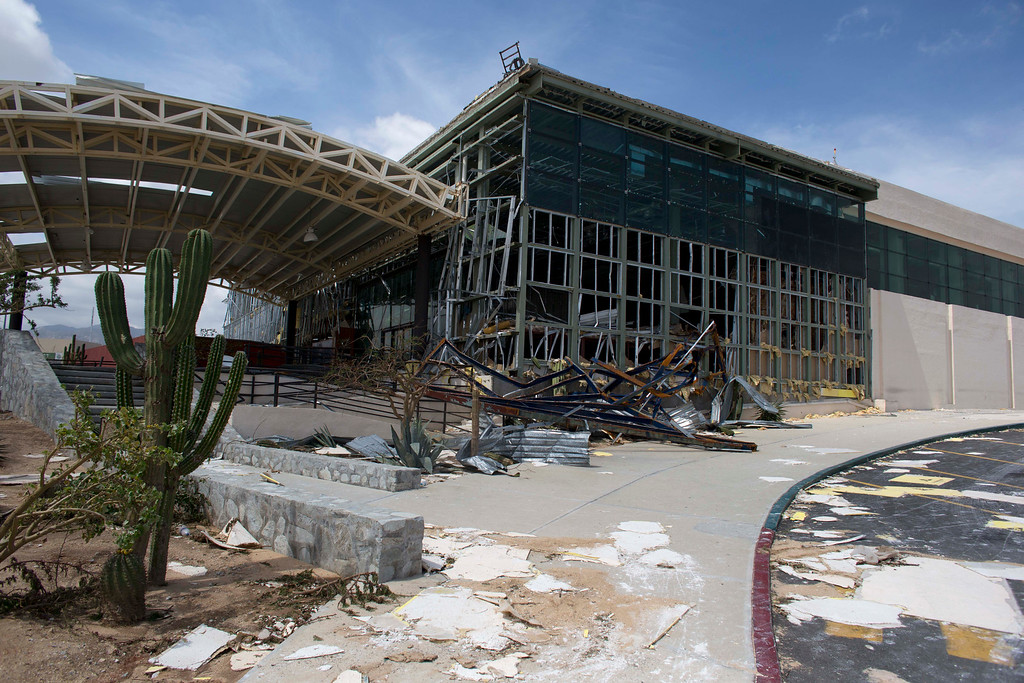 . The main entrance to the airport sits heavily damaged after hurricane Odile roared past San Jose de los Cabos, Mexico, Wednesday, Sept. 17, 2014. Odile left the resort city seriously battered and mostly without power, phone service and running water. (AP Photo/Dario Lopez-Mills)