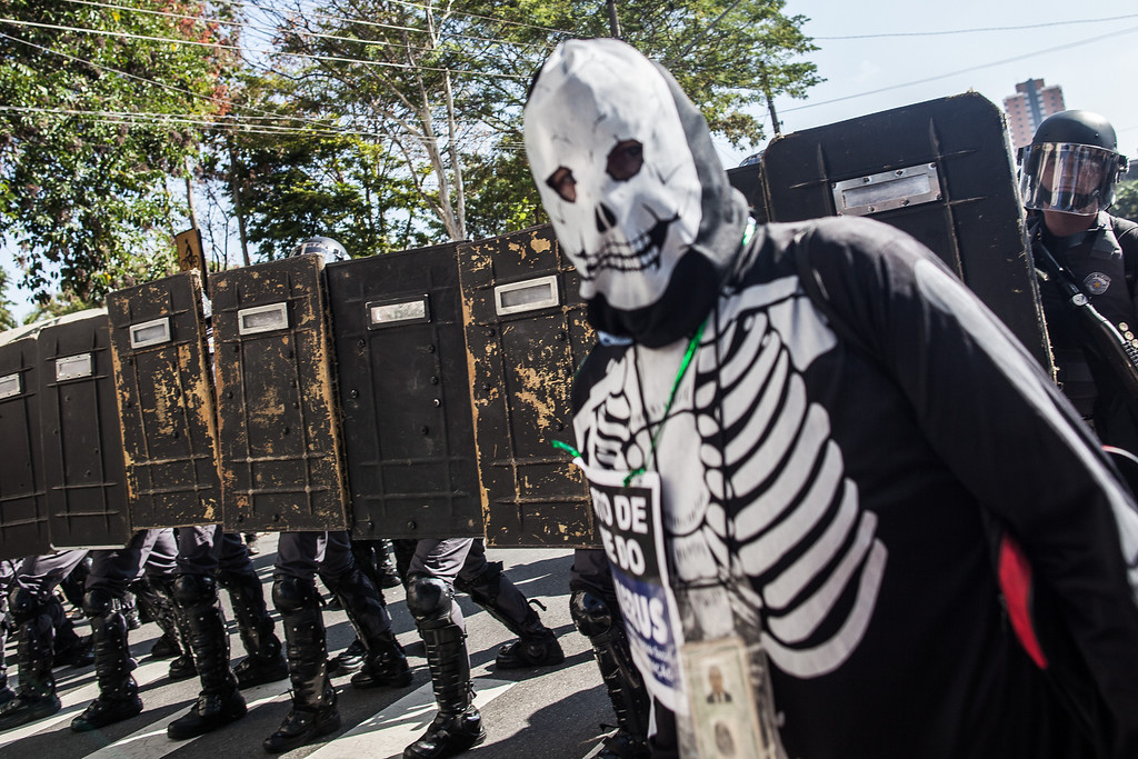 . A demonstrator stands in front of police during a World Cup protest on the opening day of the event on June 12, 2014 in Sao Paulo, Brazil.   (Photo by Victor Moriyama/Getty Images)