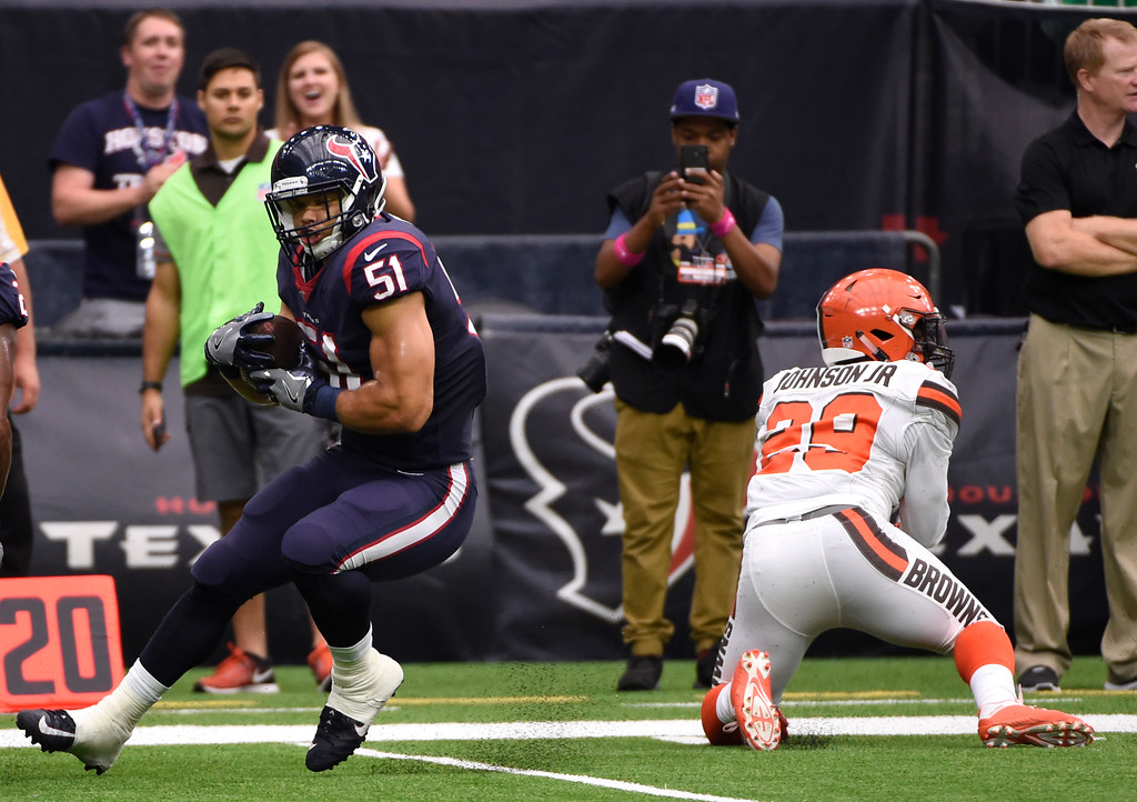. Houston Texans linebacker Dylan Cole (51) intercepts a pass intended for Cleveland Browns running back Duke Johnson Jr. (29) in the first half of an NFL football game, Sunday, Oct. 15, 2017, in Houston. (AP Photo/Eric Christian Smith)