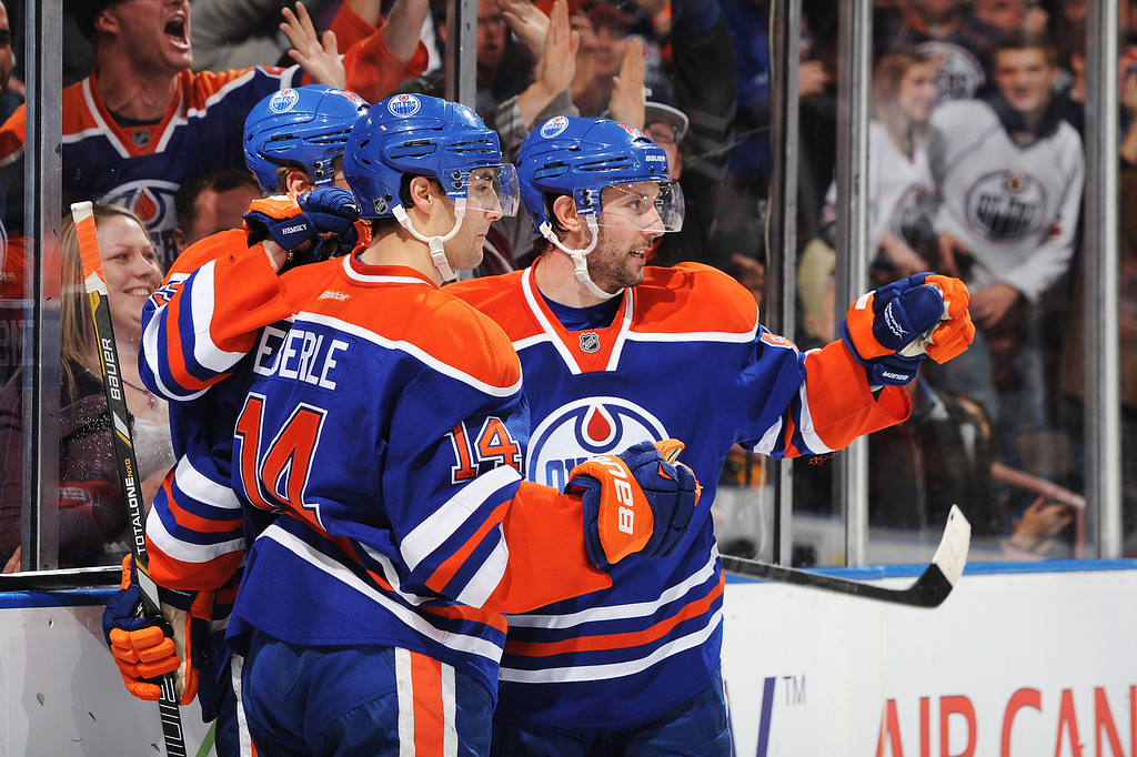. EDMONTON, CANADA - FEBRUARY 16: Ales Hemsky #83 of the Edmonton Oilers celebrates his first period goal on Semyon Varlamov #1 of the Colorado Avalanche during the NHL game at Rexall Place on February 16, 2013 in Edmonton, Alberta, Canada. (Photo by Derek Leung/Getty Images)