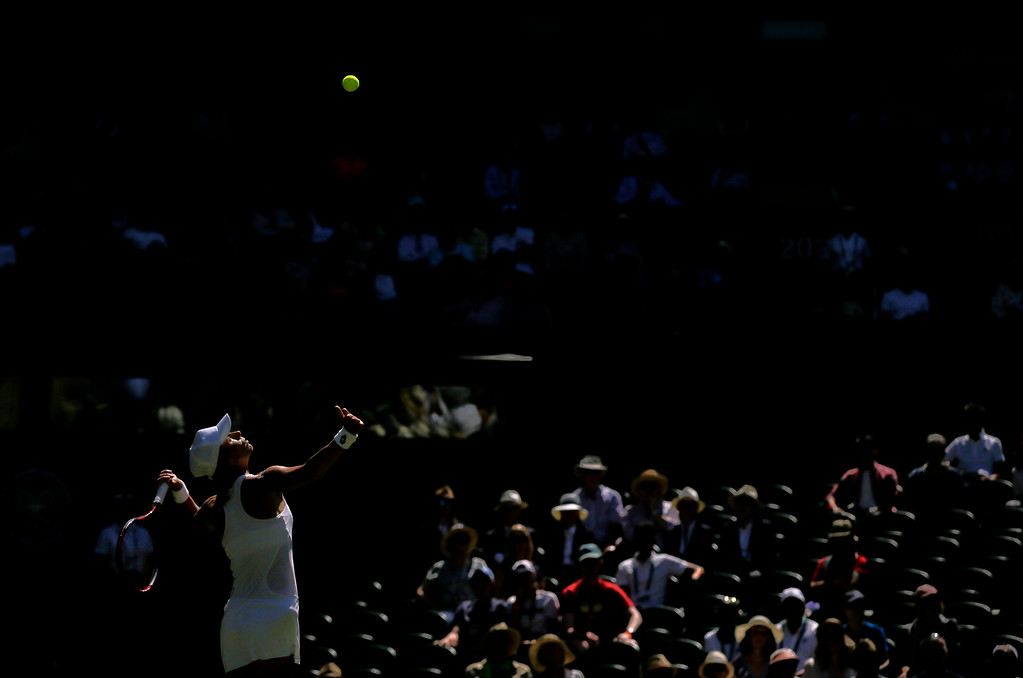. Varvara Lepchenko, of the United States, serves to Caroline Wozniacki of Denmark, during their Women\'s Singles first round match at the Wimbledon Tennis Championships in London, Monday July 2, 2018. (AP Photo/Tim Ireland)