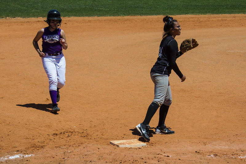 Jasmine covers third base in the first inning