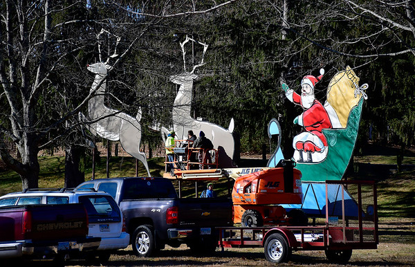 11/30/2019 Mike Orazzi | Staff Volunteers install Santa and his reindeer in Terryville's Baldwin Park on Saturday morning.