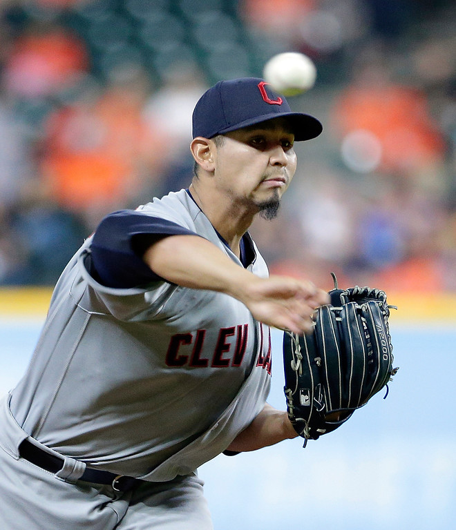 . Cleveland Indians starting pitcher Carlos Carrasco (59) throws against the Houston Astros during the first inning of a baseball game Sunday, May 20, 2018, in Houston. (AP Photo/Michael Wyke)