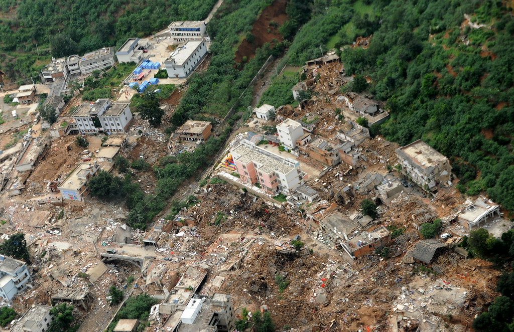 . This aerial photo provided by China\'s Xinhua News Agency shows the quake-hit Longtoushan town, Ludian county of Zhaotong, southwest China\'s Yunnan Province, after Sunday\'s earthquake Tuesday, Aug. 5, 2014.  About 10,000 troops used pickaxes and backhoes to clear roads and dig residents from collapsed homes Tuesday after an earthquake in southwest China that killed hundreds of people. Groups of volunteers, meanwhile, used their bare hands.  (AP Photo/Xinhua, Tao Liang)