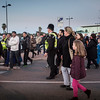 At approximately 1700hrs on the 23rd February 2014 the Spanish authorities tightened controls at the Gibraltar/Spain frontier creating up to two hour queues for pedestrians to corss into Spain. The extreme  increased controls, described by officials at the border as one of the worst in recent months, forced cross border workers and families to queue in a snake-like, zig-zag queue which filled the whole of the airport terminal car park and at one point reached the Sundial. The local authorities in Gibraltar increased their presence at the border, assisting vulnerable persons and families with children wishing to cross into Spain. The actions by the police were welcomed by those waiting who on seeing the police allow children by-pass the main bulk of the queues remained silent, even indicating other families which had been overlooked. At the time of Core Photography taking these images the police were revising their plans as the extend of the queues increased, seeking new areas to which they would have to divert pedestrians so as to reduce the pressure created within the airport terminal car park.