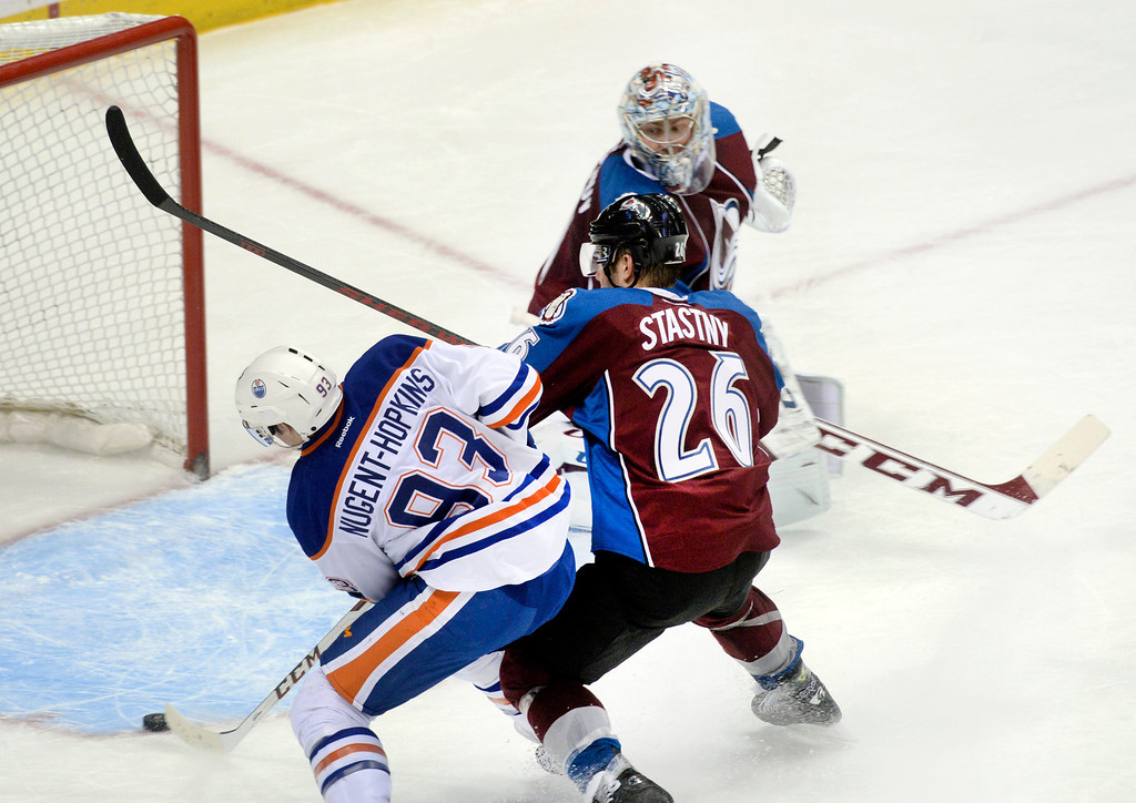 . DENVER, CO. - DECEMBER 19: Edmonton center Ryan Nugent-Hopkins (93) beat Paul Stastny and Semyon Varlamov for a goal in the second period. The Colorado Avalanche hosted the Edmonton Oilers in an NHL game at the Pepsi Center Thursday night, December 19, 2013.  Photo By Karl Gehring/The Denver Post