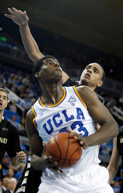 . UCLA center Tony Parker, left, pulls up to take a shot with Oakland forward Tommie McCune, right, defending in the second half of an NCAA college basketball game Tuesday, Nov. 12, 2013, in Los Angeles. UCLA won 91-60.  (AP Photo/Alex Gallardo)