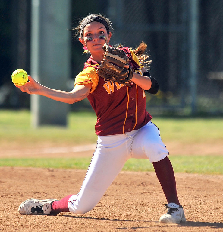 . LONG BEACH - 04/09/2013  (Photo: Scott Varley, Los Angeles Newspaper Group)  Lakewood vs Wilson girls softball at Joe Rodgers Field. Wilson SS Kori Cochran tosses the ball to 2B to get a baserunner out.