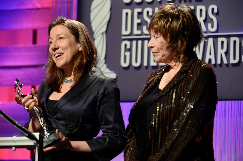 . Costume designer Jacqueline Durran and presenter Shirley MacLaine speak onstage during the 15th Annual Costume Designers Guild Awards with presenting sponsor Lacoste at The Beverly Hilton Hotel on February 19, 2013 in Beverly Hills, California.  (Photo by Frazer Harrison/Getty Images for CDG)