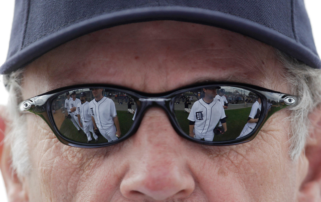. Players are reflected in the sunglasses of Detroit Tigers manager Jim Leyland during spring training baseball practice, Tuesday, Feb. 23, 2010, in Lakeland, Fla. (AP Photo/Eric Gay)
