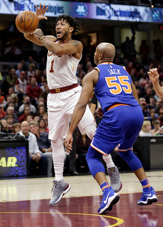 . Cleveland Cavaliers\' Derrick Rose (1) loses control of the ball against New York Knicks\' Jarrett Jack (55) in the first half of an NBA basketball game, Sunday, Oct. 29, 2017, in Cleveland. (AP Photo/Tony Dejak)