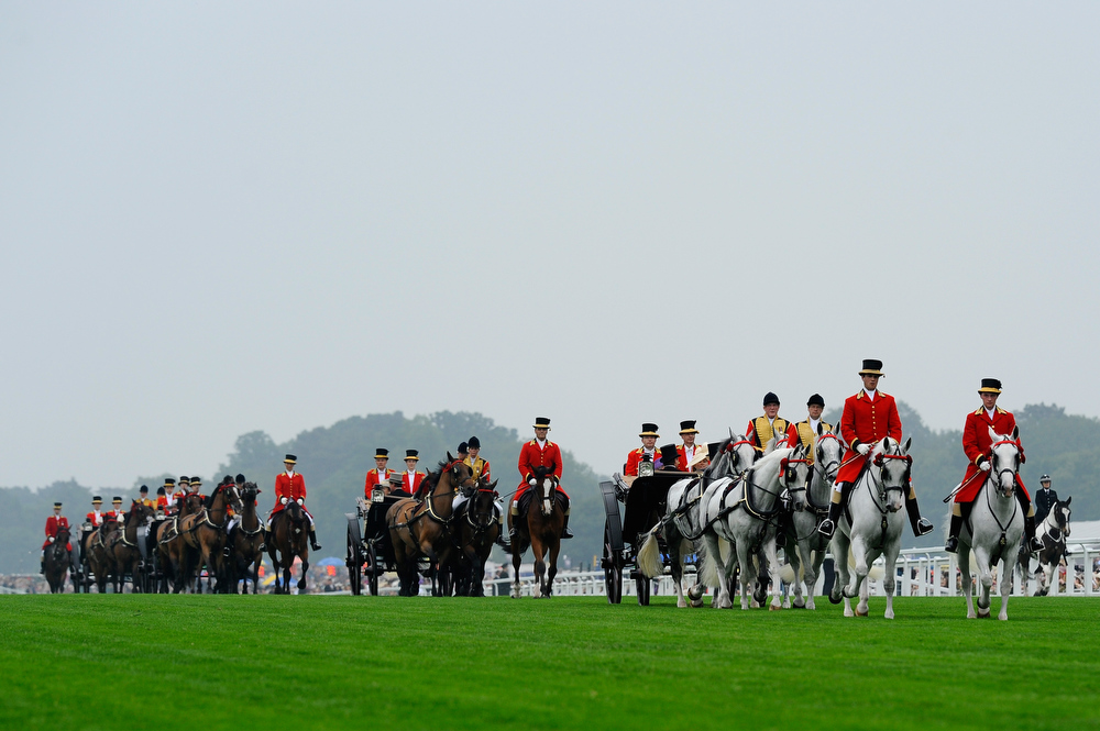 . The Royal Carriage procession makes it way up the straight mile on Ladies\' Day during day three of Royal Ascot at Ascot Racecourse on June 20, 2013 in Ascot, England.  (Photo by Alan Crowhurst/Getty Images for Ascot Racecourse)