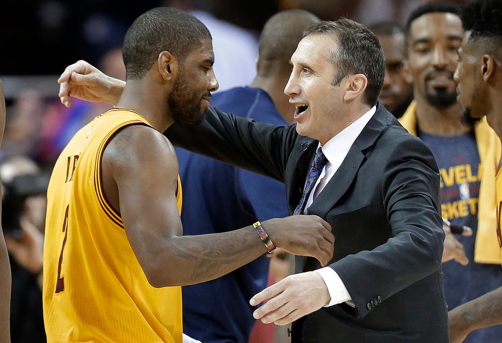 . Cleveland Cavaliers coach David Blatt greets guard Kyrie Irving as Irving comes off the court late in the second half against the Chicago Bulls in Game 5 in a second-round NBA basketball playoff series Tuesday, May 12, 2015, in Cleveland. The Cavaliers won 106-101. (AP Photo/Tony Dejak)