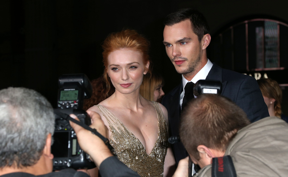 """Description of . Actress Eleanor Tomlinson (L) and actor Nicholas Hoult attend the Premiere Of New Line Cinema\'s \""""Jack The Giant Slayer\"""" at the TCL Chinese Theatre on February 26, 2013 in Hollywood, California.  (Photo by Frederick M. Brown/Getty Images)"""